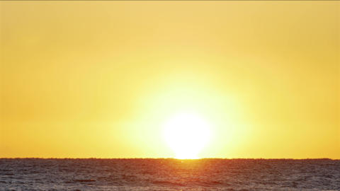 Sunrise over the sea. Amazing red sunrise on the beach. Orange color of sunrise Live Action