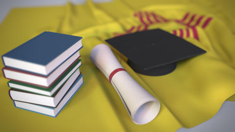 Graduation cap, books and diploma on the flag of New Mexico. Higher education in Live Action