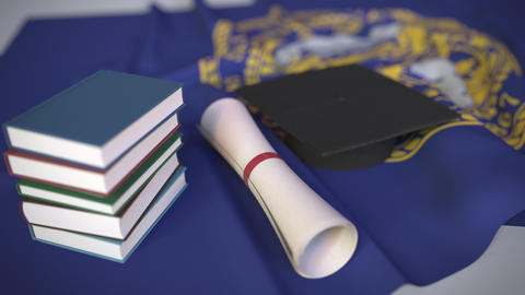 Graduation cap, books and diploma on the flag of Nebraska. Higher education in Live Action