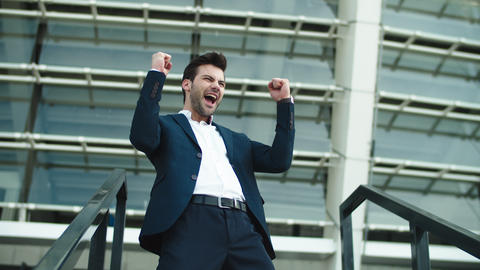 Closeup businessman celebrating victory. Businessman clapping hands outdoors Live Action