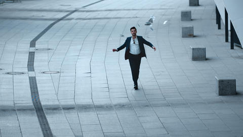Confident businessman throwing money at street. Businessman walking at city Live Action