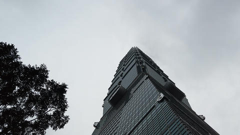 Taipei 101 tower on a cloudy day, bad weather in taiwan Live Action