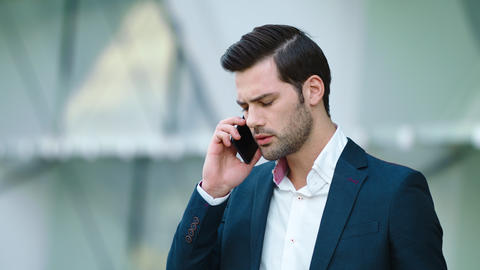 Portrait businessman talking smartphone. Man having business phone talk Live Action