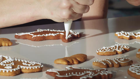 Traditional gingerbread Christmas cookies being decorated and displayed. Dolly shot. Czech Republic Live Action