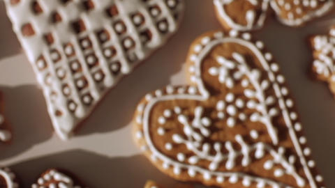 Traditional gingerbread Christmas cookies. Slow motion dolly shot. Top view, shallow depth of field. Live Action