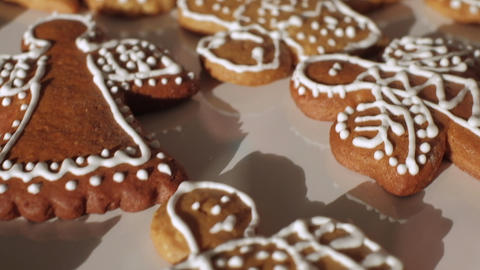Traditional gingerbread Christmas cookies being decorated. Slow motion. Czech Republic Live Action