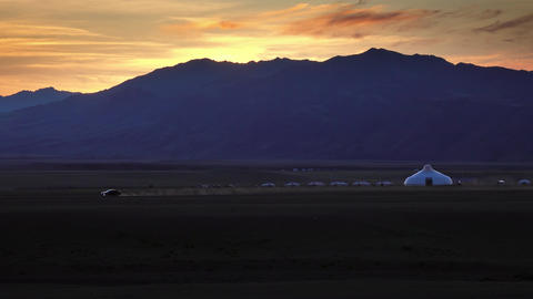 Moving car and traditional yurts after sunset Live Action
