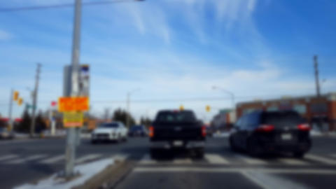 Waiting to Turn Left at City Light Intersection With Blur Effect. Being Patient to Turn in Urban Live Action