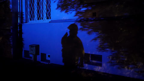 Shadow of a fireman with a radio on the wall Live Action