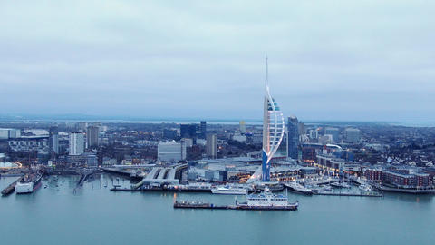 Harbour of Portsmouth England with famous Spinnaker Tower - aerial view Live Action