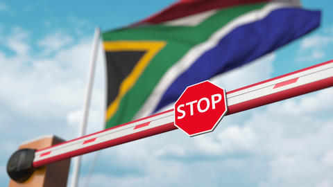 Barrier gate being opened with flag of South africa as a background. South Live Action