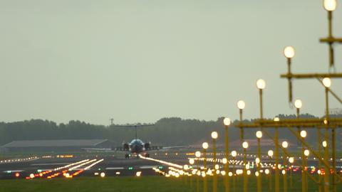 Airplane braking after landing on runway Live Action