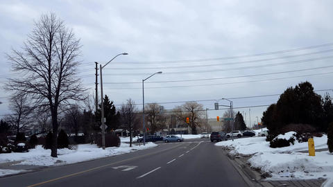 Cars Driving on Busy Street at City Light Intersection in Winter. Vehicles Travelling on Urban Road Live Action