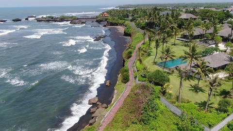 Cliffs of Bali Island in windy weather. Aerial Live Action
