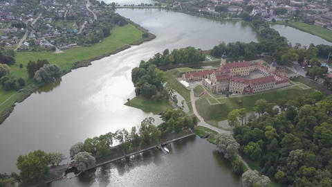 Aerial shot of the famous Nesvizh castle in sunny weather, located in the old Live Action