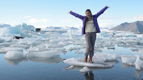 Iceland travel tourist walking on Ice in landscape at famous tourist destination Live Action