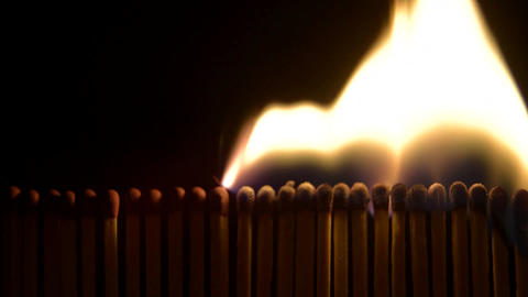 Row of matches being lit and burning ビデオ