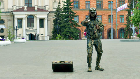 Living Statue in Steam-Punk Style Posing Next to Suitcase for Donations Footage