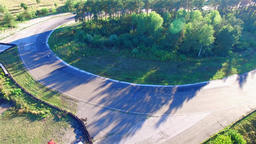 Motorcycle racing 4k aerial video. Moto riders in turn on circuit road track Footage
