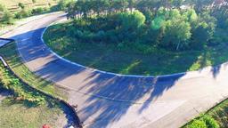 Motorcycle racing 4k aerial video. Moto riders in turn on circuit road track Footage
