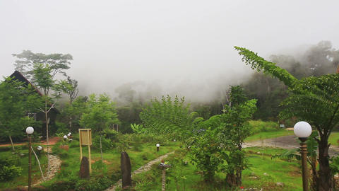 Yersin House Back Site against White Thick Mist in Mountains Footage