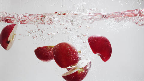 Apple Falls Into Water in Slow Motion Footage
