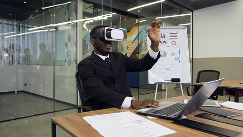 Attractive portrait of focused young african american businesman in virtual Live Action