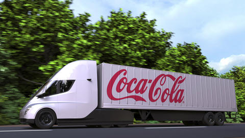 Electric semi-trailer truck with COCA-COLA logo on the side. Editorial loopable Acción en vivo
