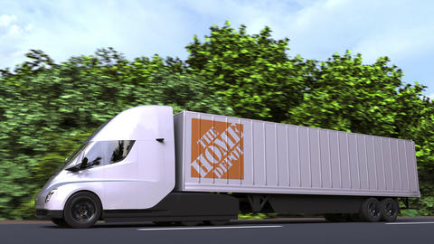 Electric semi-trailer truck with THE HOME DEPOT logo on the side. Editorial Acción en vivo
