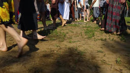 Group of people walking barefoot in park Live Action