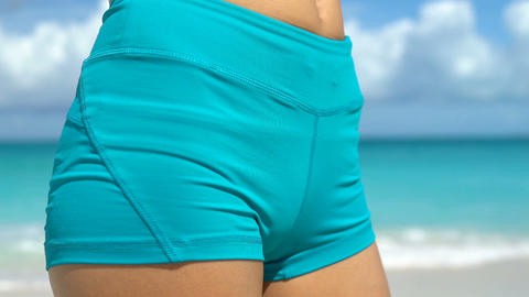 Slim waist close up of sporty woman on beach - Weight Loss Concept Live Action