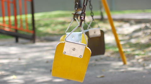 Empty swing swing. The concept of loneliness Live Action