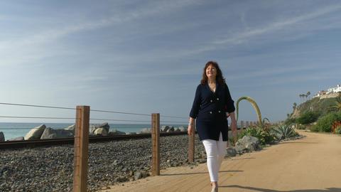 Woman happy Beautiful sunny summer Day Walking ocean coast. Travel Vacation Live Action