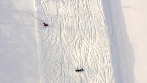 Drone flying over moving ski elevator on snowy slope in mountain resort. Top aerial view ski lift Live Action