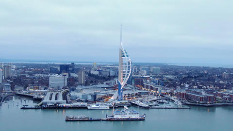 Harbour of Portsmouth England with famous Spinnaker Tower - aerial view - Live Action