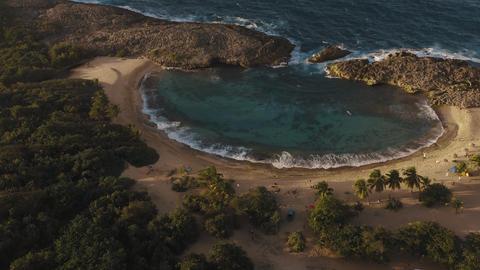 Establishing shot of Playa Mar Chiquita Beach in Puerto Rico at magic hour Live Action