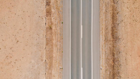 Top view drone, zoom out above narrow desert road Live影片