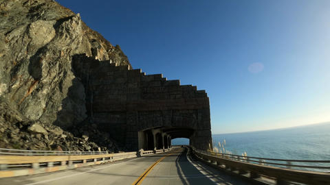 Scenic road Driving thru tunnel arches Rain Rocks Rock Shed and Pitkins Curve Live Action