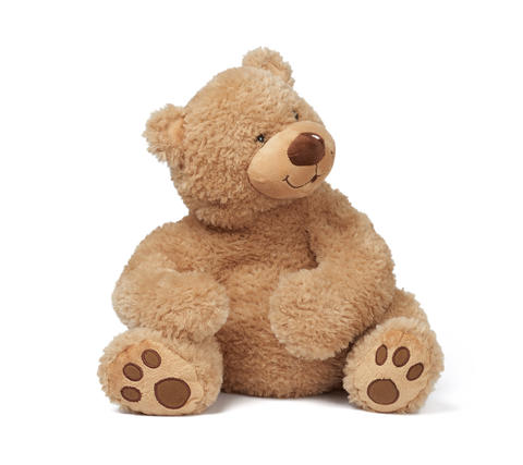 big curly brown teddy bear sits on a white isolated background Fotografía