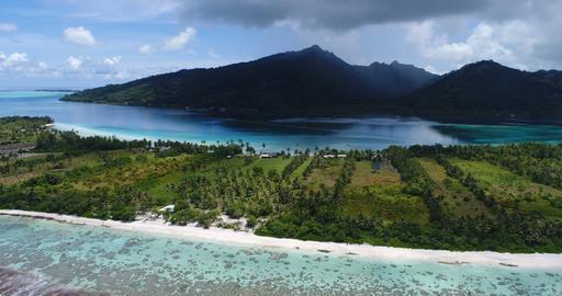 French Polynesia Tahiti aerial view of island Huahine and Motu coral reef lagoon Live Action