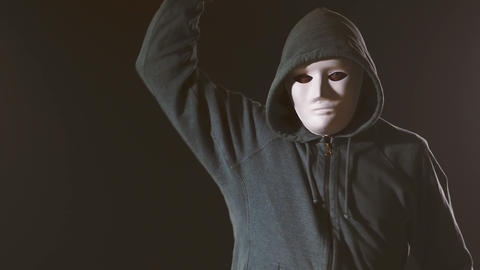 Killer in white mask and hoodie cuts with knife Live Action