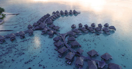 Travel vacation paradise aerial video with overwater bungalows on coral reef sea Live Action