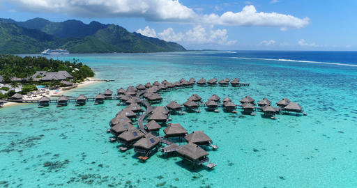 Travel vacation paradise aerial video with overwater bungalows in coral reef sea Live Action