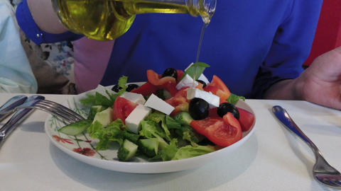 Fresh tasty greek salad on a table in a restaurant Live Action