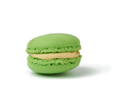 green round baked almond flour macaron isolated on a white backg Fotografía