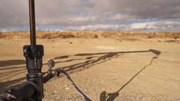 Pump Jack Shaft With Oil Well Shadow Dirt Wyoming Footage