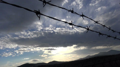 Barbed Wire against the Cloudy Sky (1) Footage