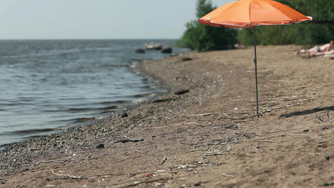 Orange beach umbrella Footage