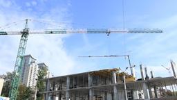 Elevating construction crane against blue sky Footage