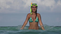 Woman Wearing Bikini And Snorkel In Ocean Live Action